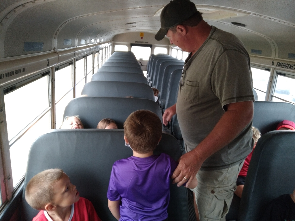 Mr. Joe show student how they should NOT sit on the bus.